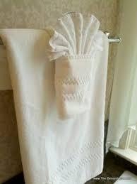 bathroom towel folding ideas fancy towel folding with dragonfly bling pinteres