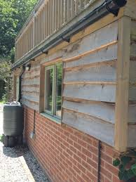 bespoke garage workshop logstore first floor playroom and roof