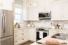 white kitchen cabinets with gold countertops white kitchen cabinets with gold and gray granite