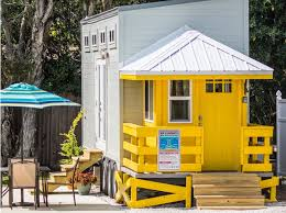 house with a porch we re swooning this tiny house rental with a lifeguard stand as