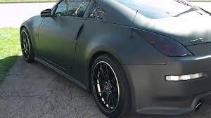blue nissan 350z with black rims 1 sick flat matte black nissan 350z with hide away license