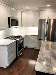 merillat kitchen cabinet hinges kitchen renovation in grays and white counter tops are