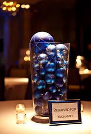 glass vases filled with on theme ornaments served as centerpieces