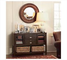dresser foyer ideas features round mirror and drawers wooden table