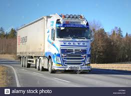 2015 volvo 18 wheeler big white semi trailer cargo truck transports goods along motorway