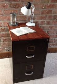 metal desk with file cabinet like the idea to add wood to top of this filing cabinet makes it