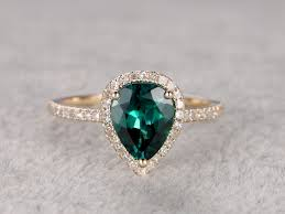 and emerald engagement rings pear shaped emerald engagement ring yellow gold halo