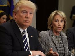 betsy devos would not rule out withholding funds from schools