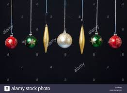 an assortment of ornaments hanging in display stock photo