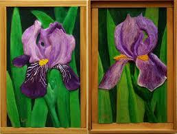 two iris painted wood carvings