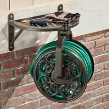 water hose reel wall mount the perfect pivot hose reel hammacher schlemmer