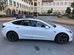 tesla jeep tesla model 3 first test drives hit the road in the u s