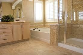 rectangle white concrete corner bathtub between glass shower stall