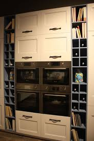 clever design features that maximize your kitchen storage built in appliances flanked by wine storage spaces