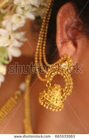 new fashion gold earrings unique gold earrings stock photo 665533063