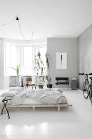 home staging chambre light bedroom with a concrete wall coco lapine designcoco lapine