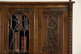 antique bookcase glass doors sold dutch carved oak 1915 antique gothic library bookcase