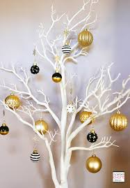 tree with black and gold ornaments home quotes