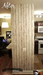 wallpapering an accent wall with faux wood hometalk