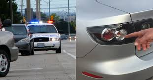 why do cops touch tail lights why cops tap your taillights when they pull you over