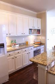 white wood kitchen cabinets kitchen design colors ideas black ceramic floor tile white cabinet