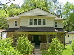 Exterior House Paint Schemes - nice beige exterior house paint with dark chocolate roof paint