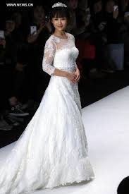 wedding dress daily models present wedding gowns at china fashion week s