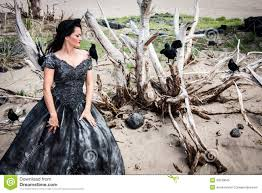 woman in black wedding gown with crows royalty free stock photo