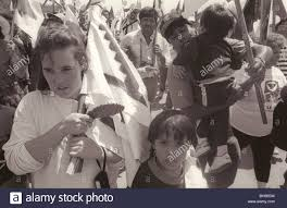 Black Flag Family Latino Family Marching With Ufw Marchers At Cesar Chavez Funeral