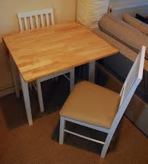 extending solid dining table and 2 chairs two tone argos