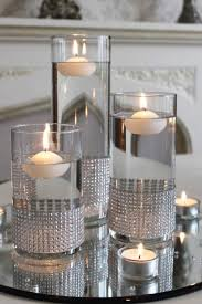 silver centerpieces set of cylinder vases with diamante bands and placed on a mirror
