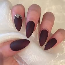 matte burgundy stiletto with elegant design nails by georgia