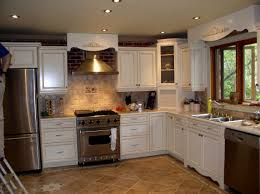 white kitchen cabinets with brown floors white kitchen cabinets brown tile floor kitchen remodel