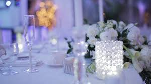 decorative table setting with empty wine glasses at a wedding