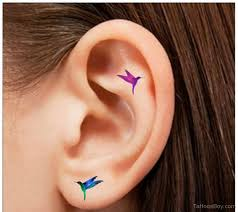 small bird on ear designs pictures