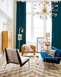 mid century mixed with a jonathan adler velvet sofa is a recipe