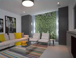 basement living room features vertical wall recessed lights drum