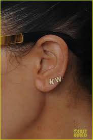 kanye west earrings wears kanye west initials earrings photo 2652830