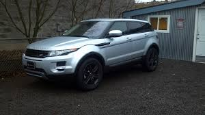 black land rover with black rims choosing the perfect custom wheel color is all about knowing your