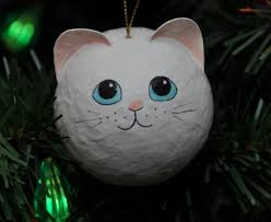 white cat ornament rainforest islands ferry
