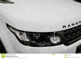 white land rover front view headlight of a white land rover range rover sport 2017
