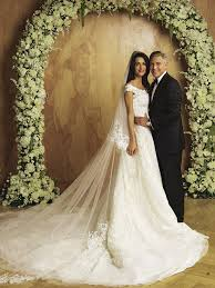 oscar de la renta lace wedding dress amal clooney s wedding dress is headed to houston epic
