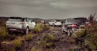 porsche cayenne or range rover sport luxury suv comparison bmw x5 v mercedes ml class v range