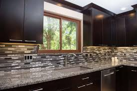 traditional kitchen with quartz countertops and white cabinets