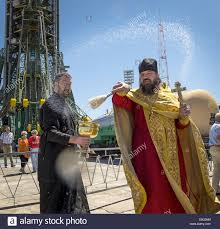 a russian orthodox priest blesses members of the media shortly