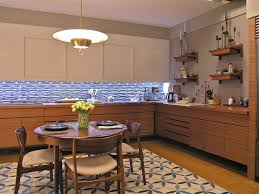 architecture blue lighted backsplash with dark wood cabinets