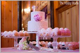 wedding cake display vintage lace wedding cake and cupcake at tavern and chapel in the