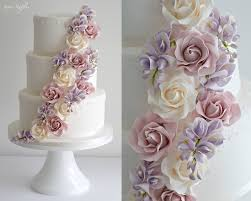 wedding cake flowers wedding cake with cascading roses and wisteria sugar flowers