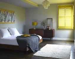 yellow and grey room living room shutters add cheerful yellow glow to the bedroom grey