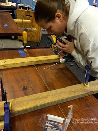 Industrial Bookcase Diy Remodelaholic Diy Industrial Pipe Shelves And Desk